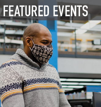 a happy person wearing a mask, attending a special event in the library