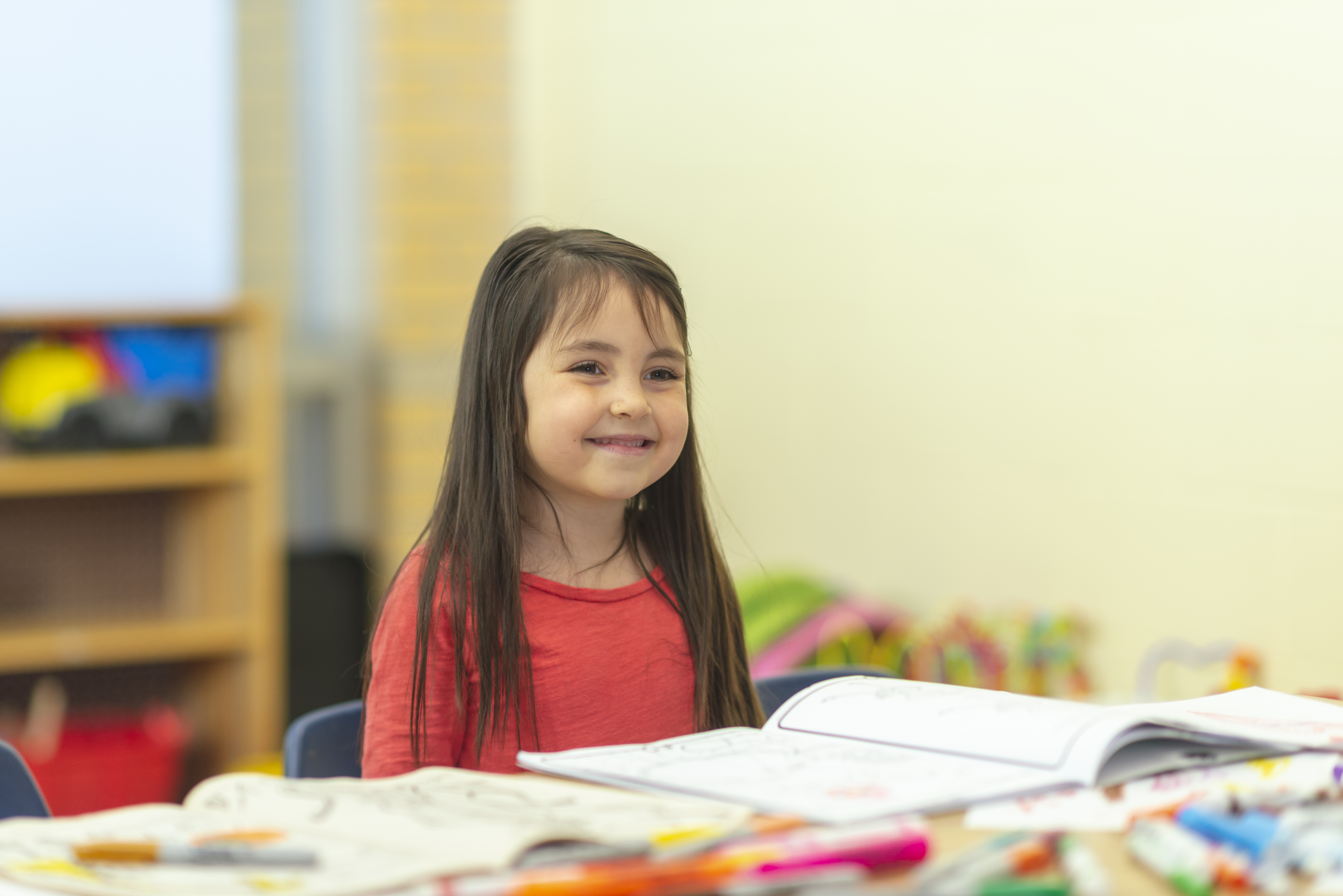 Happy child with books
