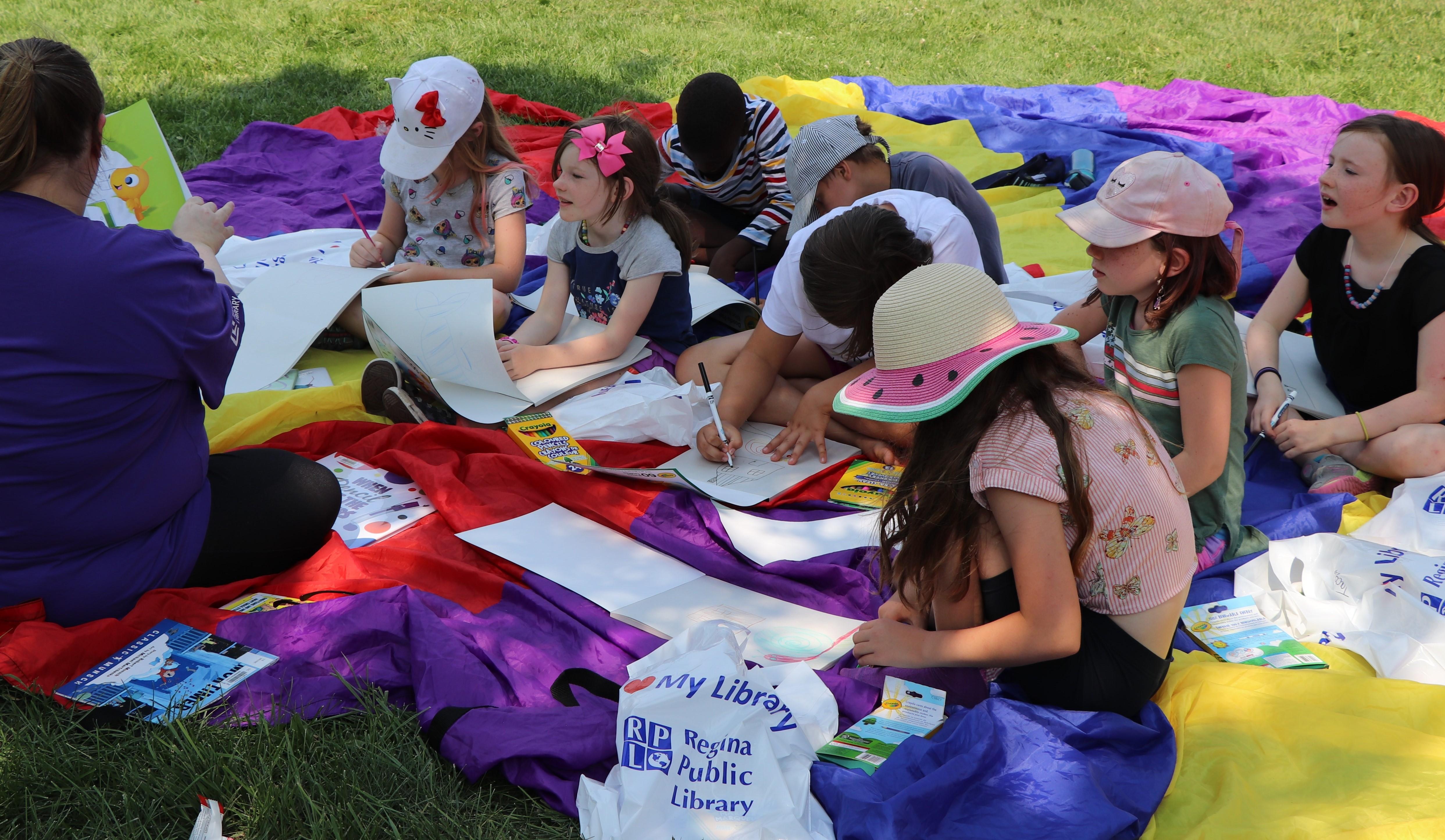 Children enjoying storytime in the park